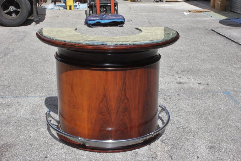 Monumental French Art Deco Macassar ebony semicircle dry bar marble top, circa 1940s. Very nice green color of the marble top ,with the chrome stole foot ,the dry bar are in perfect condition ,beautiful bar were anyone can good time with some