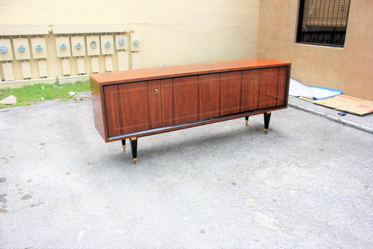 Beautiful French Art Deco exotic Macassar ebony sideboard, buffet or bar, circa 1940s. the sideboard are in very good condition, with three drawers inside, with two shelves adjustable, and bar section, you can remove all the shelves if you need more