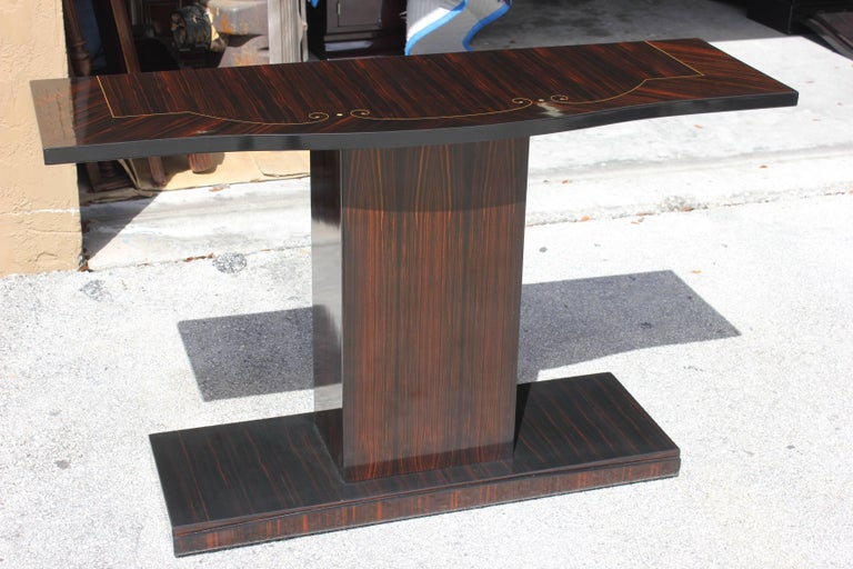 Rare pair of matching French Art Deco exotic Macassar ebony console tables with mother-of-pearl detail, circa 1940s. Stunning detail. Perfect for foyer or entryway.