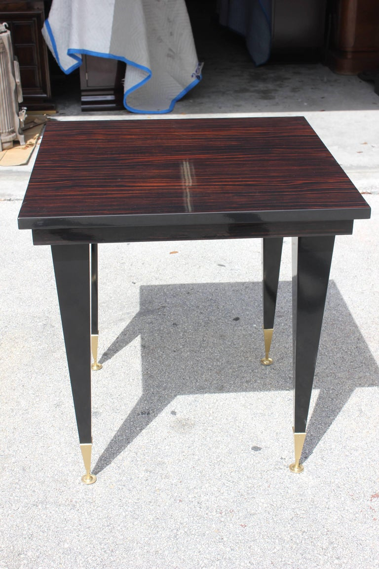 A beautiful French Art Deco exotic Macassar ebony game table or center table, circa 1940s. Refinished high gloss finish. Part of a collection from a French casino.