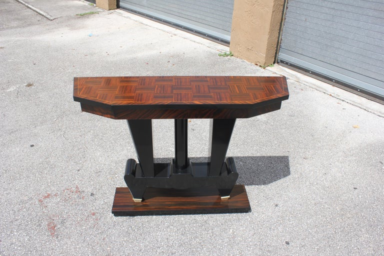 Beautiful French Art Deco exotic Macassar ebony console tables, circa 1940s. Beautiful Macassar ebony with black lacquer centre base, finish in both side, beautiful bronze hardware detail, that rest on makes it ideal for use as a bedside table or