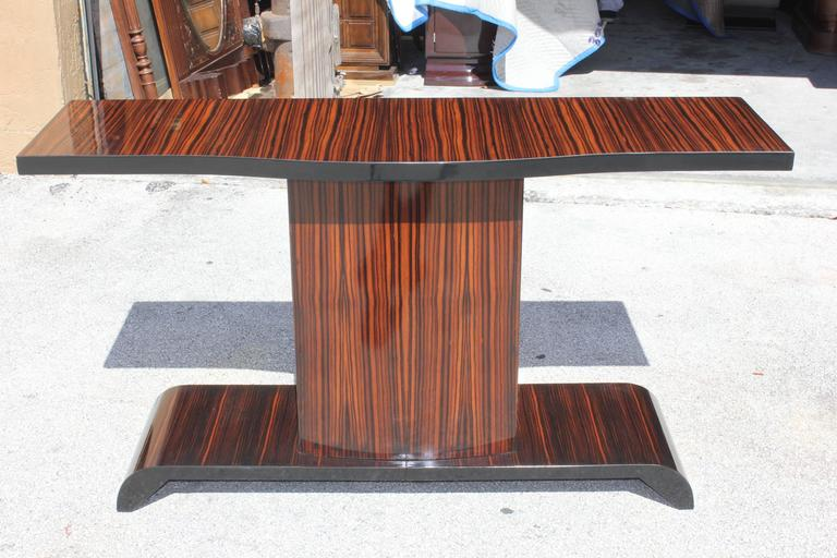 A gorgeous French Art Deco Exotic Macassar Ebony Console Table with grand proportions. This piece will be the focal point in the room.