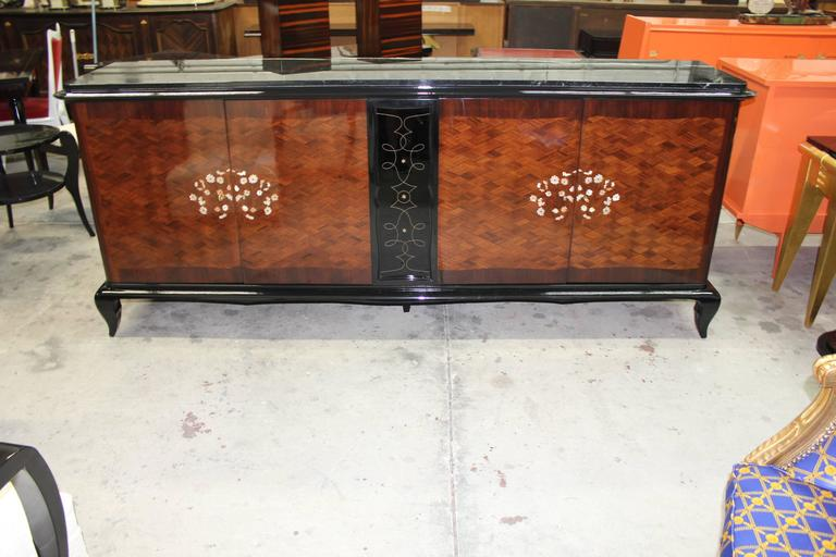 A stunning French Art Deco palisander marquetry with mother-of-pearl and black opaline glass accented sideboards, buffets or bar. Beautiful detail throughout, in the style of the master Jules Leleu. Very fine craftsmanship and finished interior,