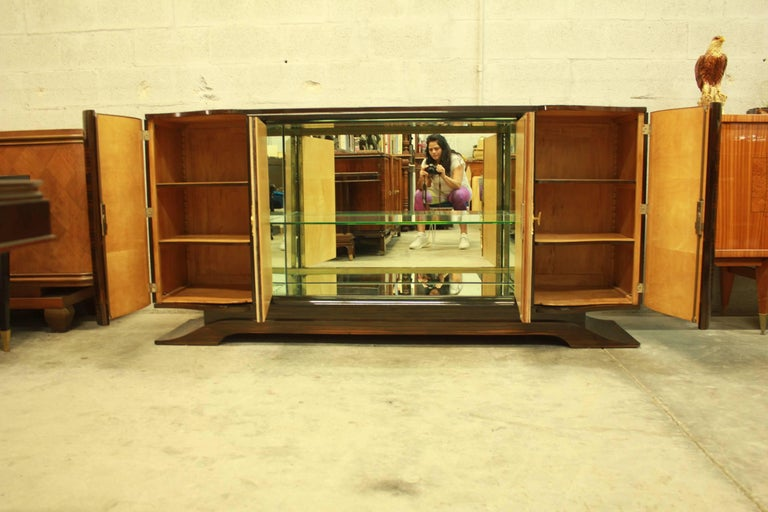 Beautiful masterpiece French Art Deco Macassar ebony, diamond parchment center doors, sideboard or bar designed by Maurice Rinck, completely refinished high gloss. With center bar mirror and shelves glass, sycamore wood interiors, all four wood