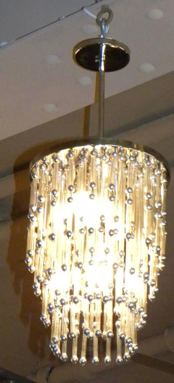 Unusual Art Deco style chandelier. Fun piece with a lot of style. Found in Argentina, just recently restored throughout. The piece may actually be from the 1960s but its simple point of view allows it to work in a very stylized Art Deco