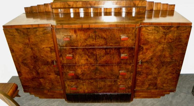 French Art Deco buffet or storage cabinet with some of the most spectacular bookmatched walnut wood veneer I've ever seen. This piece offers a nice and very useable size, with large storage opening on each side and four matching drawers with