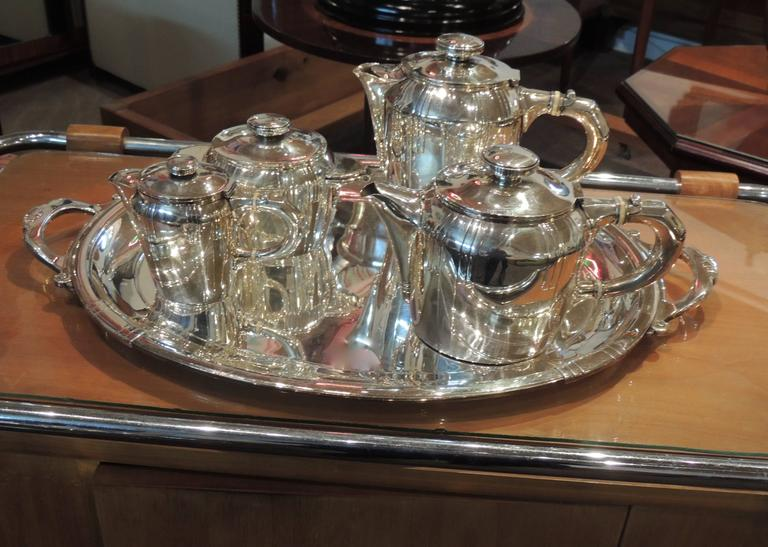 """Complete French Art Deco silver plate tea and coffee Set from the """"Golden Age"""" of Buenos Aires when the city was one of the richest in the world and brimming with the artistic influence of Europe. There was a fashion for English High Tea, offered"""
