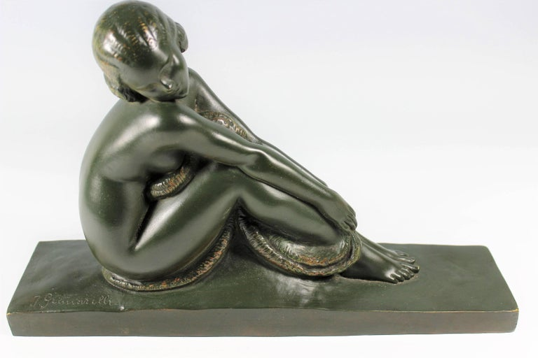 An original patinated bronze nude by Amedeo Gennarelli, circa 1925. This demure young nude model, depicted seated with knees raised and her head resting on her shoulder. A deep green patina signed in the cast 'A.Genneralli'.  Amedeo Gennarelli