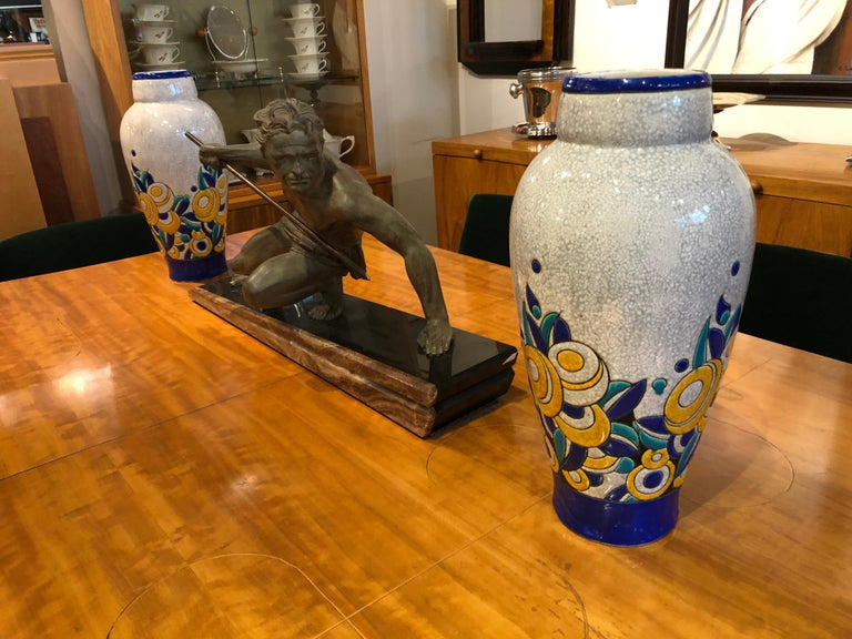Stunning matching pair of large Boch Freres vases designed during the Charles Catteau period. Ceramic cloisonné is defined by colors contained by a line. You can see the hand made quality with the enamel paint which seems to expand beyond the line,