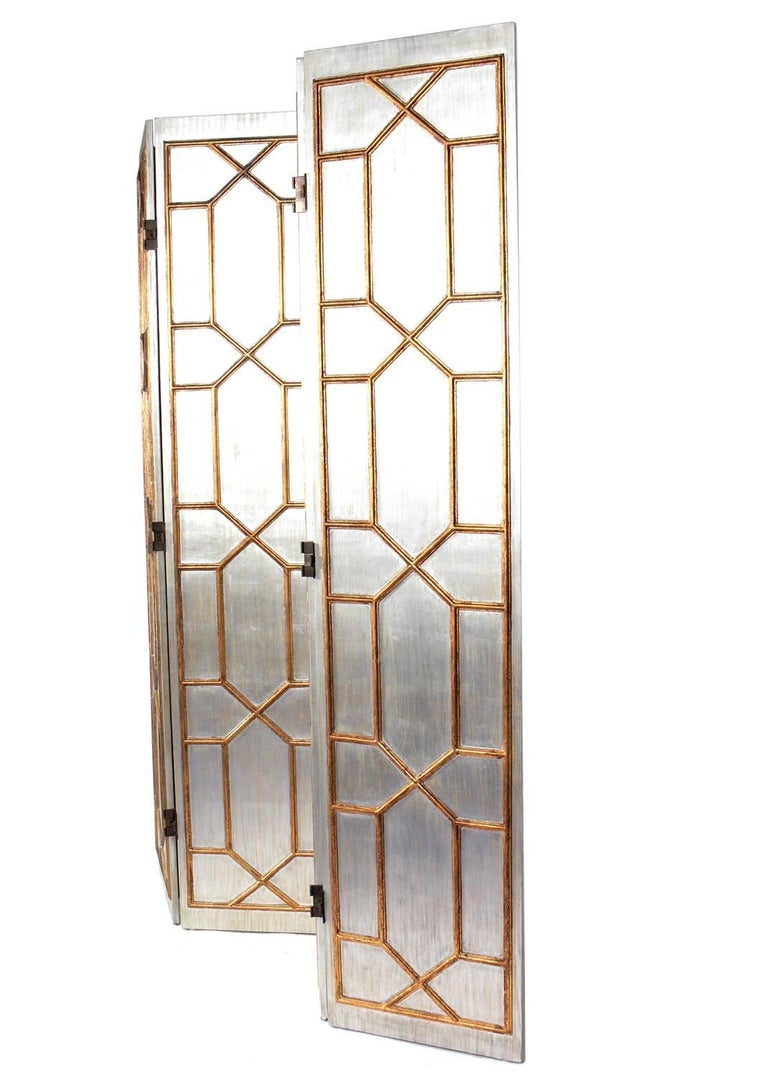 Glamorous silver and gold gilt folding screen or room divider, American, circa 1960s.