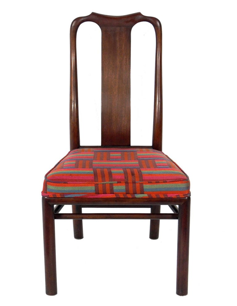 Set of eight dining chairs with subtle Asian influence, designed by Michael Taylor for Baker, American, circa 1960s. These chairs are currently being refinished and reupholstered and can be completed in your choice of finish color and your fabric.