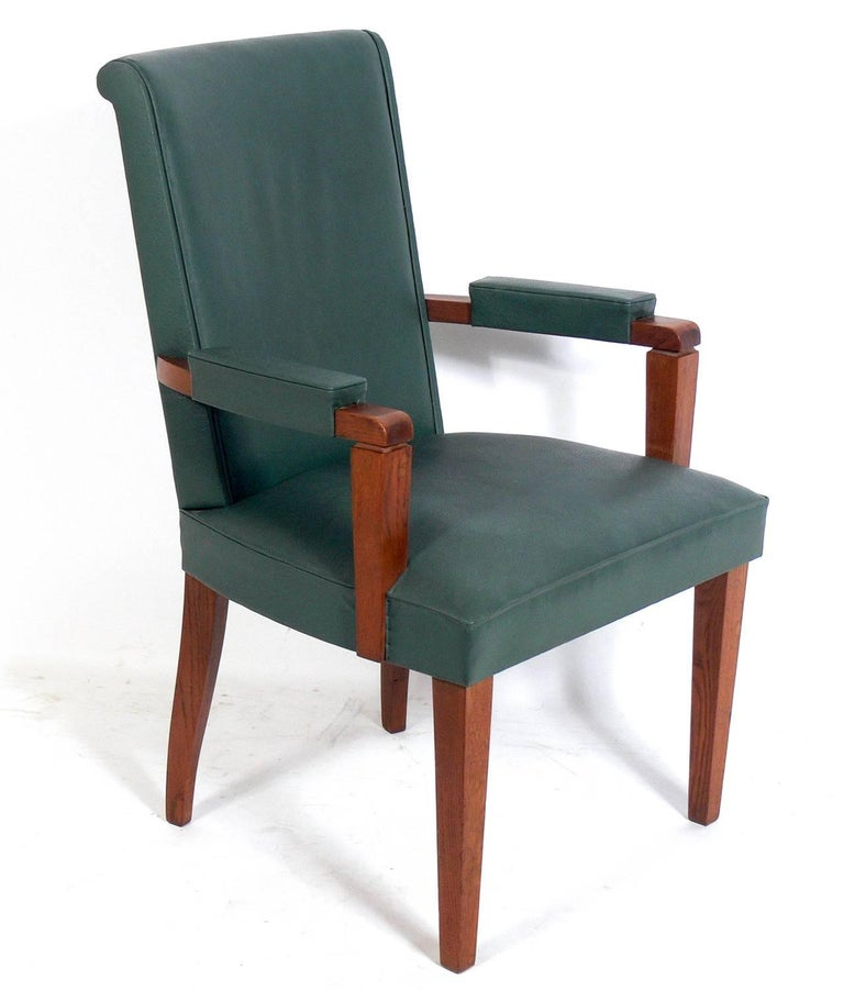 Set of Six French Art Deco oak dining chairs, in the manner of Andre Arbus, French, circa 1940s. These chairs are currently being reupholstered, as one chair has significant wear to it's upholstery. The priced noted below includes reupholstery in