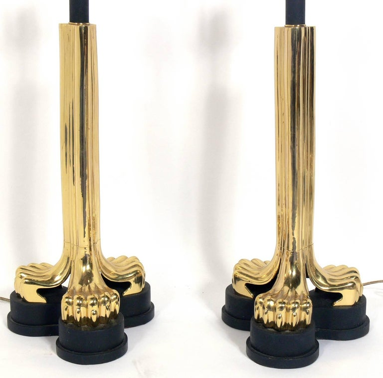 Pair of Zoomorphic brass lamps, American, circa 1970s. They have sculptural claw feet in black and brass. Rewired and ready to use. They price noted includes the shades.