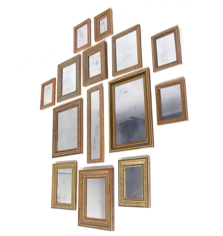 Collection of Moroccan Mosaic Framed Mirrors, circa 1960s. Each mirror frame is hand made with the painstaking precision of tiny inlaid mosaic pieces. The price listed is for the entire collection of 14 mirrors. We will not break up the collection.