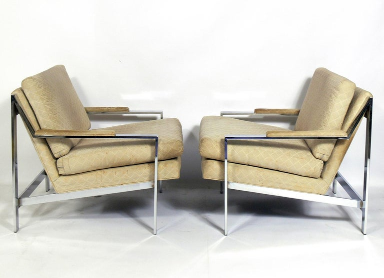 Pair of chrome lounge chairs by Cy Mann, American, circa 1960s. For years these chairs were attributed to Milo Baughman. These chairs are currently being reupholstered and can be completed in your fabric at no additional charge. The price noted