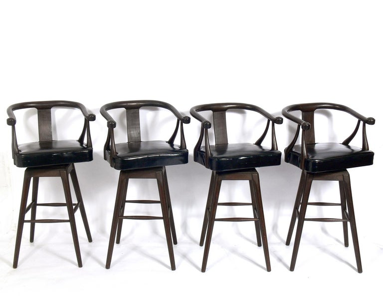 Set of four Asian style midcentury bar stools, circa 1960s. Very reminiscent of the Edward Wormley for Dunbar designed