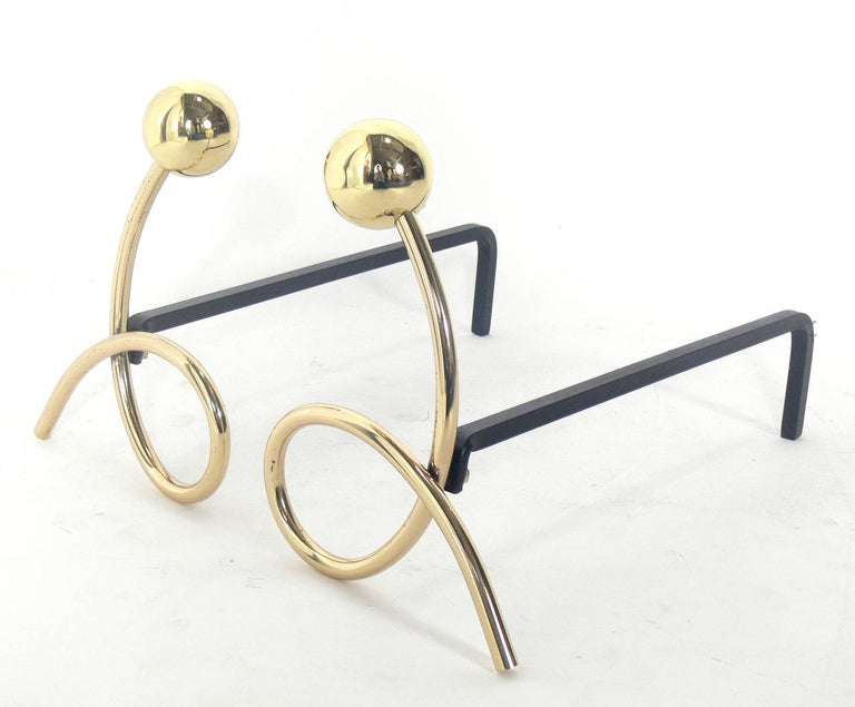 Whimsical brass loop andirons, in the manner of Jean Royère, circa 1950s. Hand polished and lacquered.
