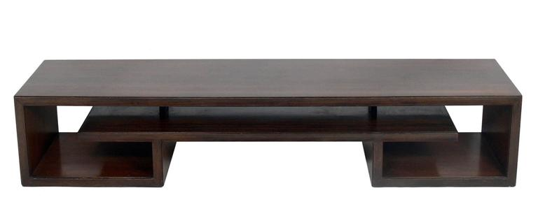 Asian Form Rosewood Coffee Table or Bench, designed by Paul Frankl for Johnson Furniture, American, circa 1950's. It exhibits an elegant Asian scroll design with beautifully grained rosewood. It is a versatile size and can be used as a coffee table