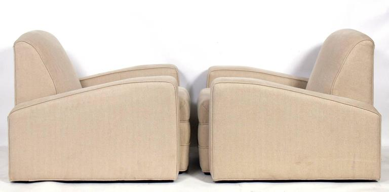 Pair of low slung Art Deco lounge chairs, French, 1930s. They have a chic low slung form. They are currently being reupholstered and can be completed in your fabric. The price noted below includes reupholstery in your fabric.