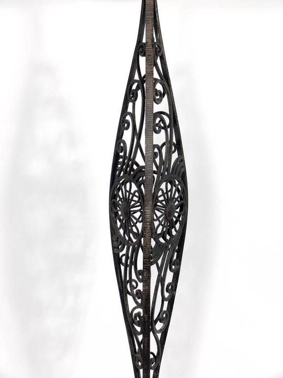 French Art Deco iron floor lamp, in the manner of Edgar Brandt, French, circa 1930s. It has been rewired and is ready to use.
