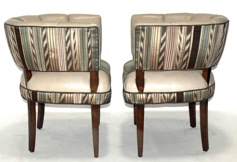 Pair of curvaceous chairs, designed by Gilbert Rohde, American, circa 1930s. These chairs are currently being refinished and reupholstered and can be completed in your choice of finish color and your fabric. The price noted below