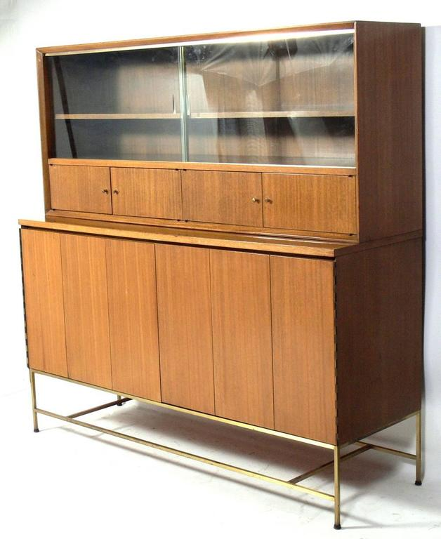 Mid-Century Modern credenza, designed by Paul McCobb for Calvin, circa 1950s. This piece is a versatile size and can be used as a credenza, bar, bookcase, chest, dresser, bookcase, or server. It offers a voluminous amount of storage with numerous