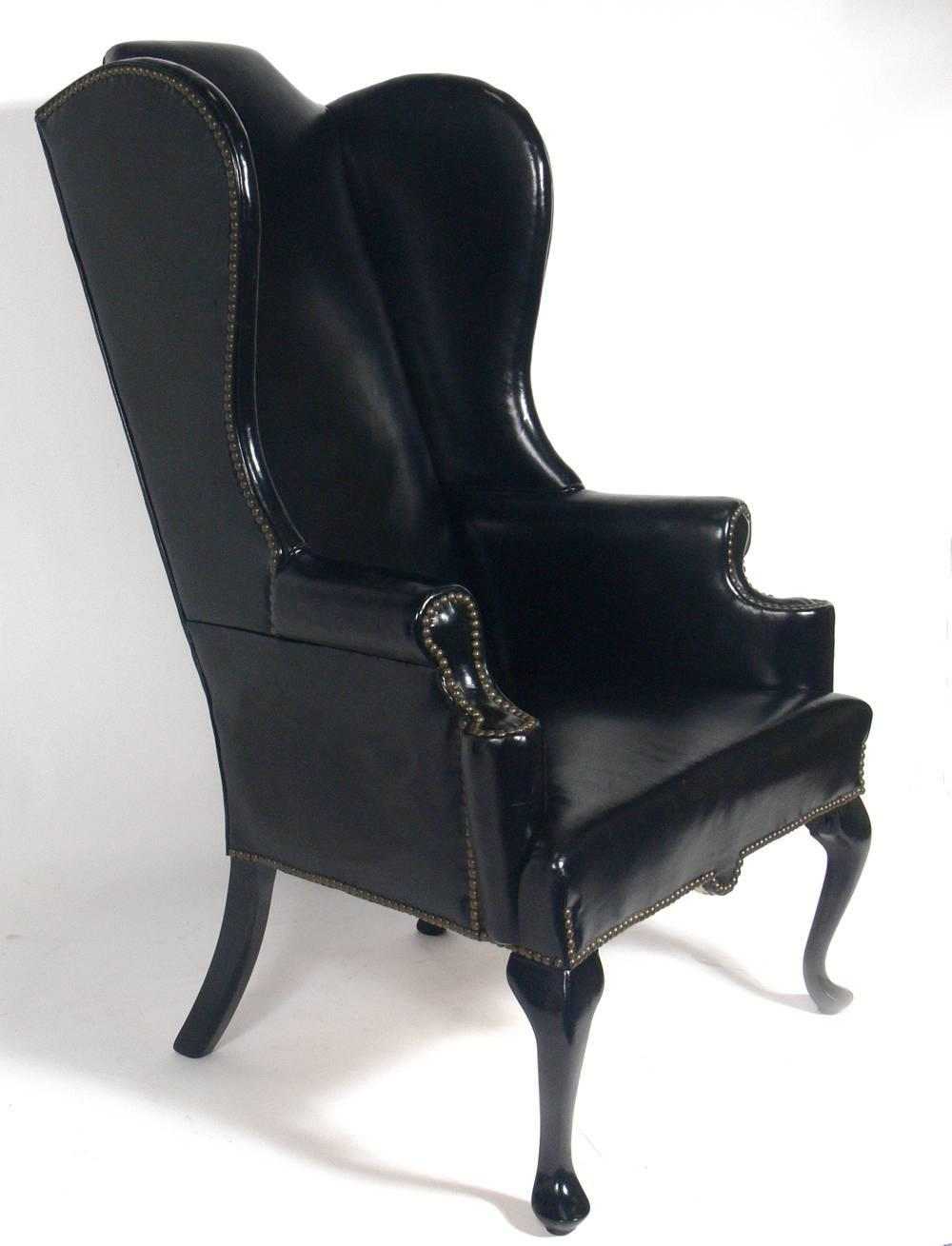 perfectly patinated black leather wing chair for sale at 1stdibs. Black Bedroom Furniture Sets. Home Design Ideas