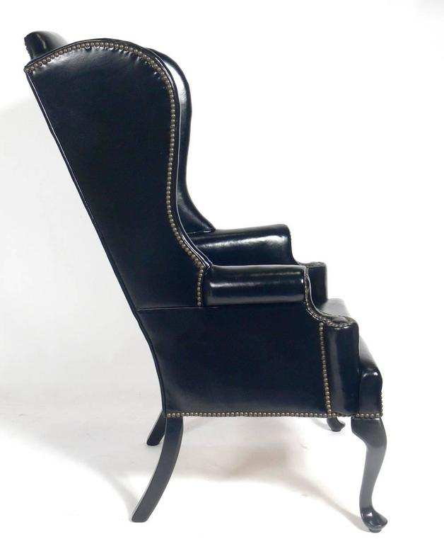 American Perfectly Patinated Black Leather Wing Chair For Sale