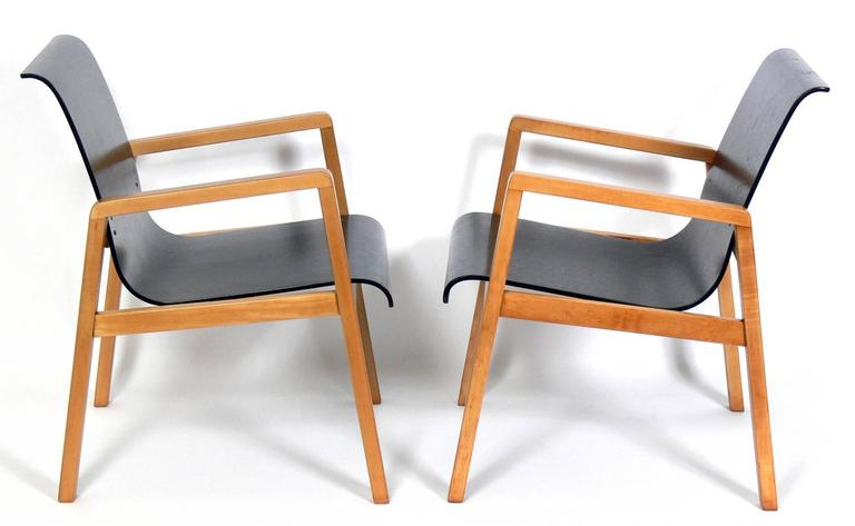 Pair of bentwood modern lounge chairs, designed by Alvar Aalto, circa 1940s. They have been refinished and are ready to use.
