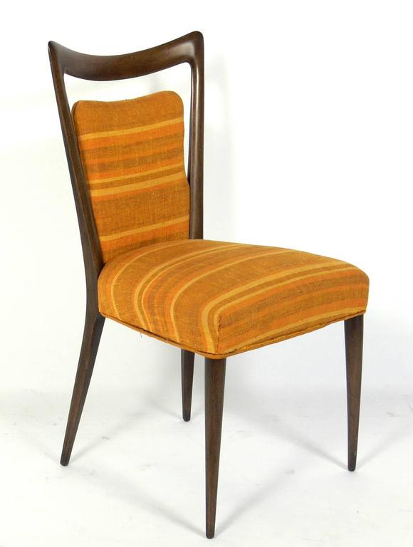 Set of four Italian modern dining chairs, designed by Melchiorre Bega, Italian, circa 1950s. These chairs are currently being refinished and reupholstered. The price noted below includes refinishing in your choice of color and re-upholstery in your