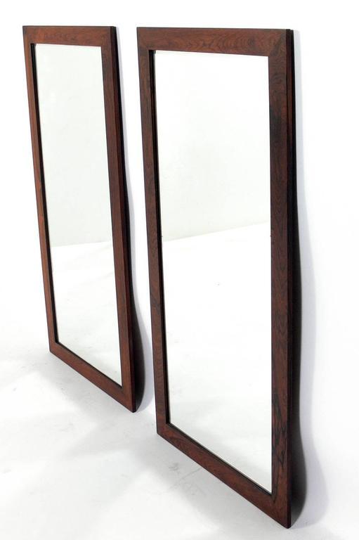 Pair of Danish Modern rosewood mirrors, Denmark, circa 1960s.