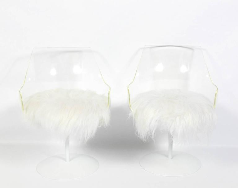Pair of sculptural Lucite chairs, designed by Erwine and Estelle Laverne, American, circa 1960s. They have been repainted and reupholstered in soft long hair wool. The chairs swivel on the bases.