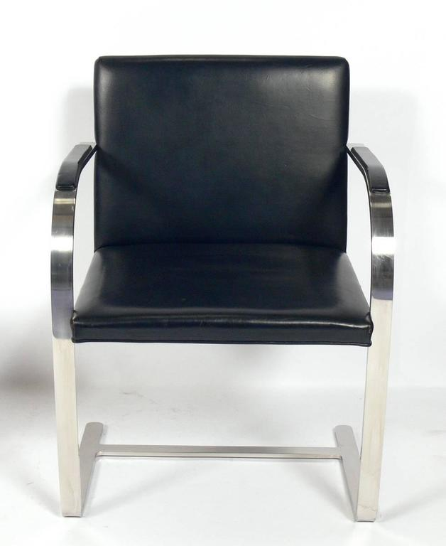 Pair of Brno chrome chairs, designed by Mies Van Der Rohe for Knoll, American, circa 1960s. These chairs retain their original black leather upholstery. One chair has a small tear at the lower portion of the backrest.