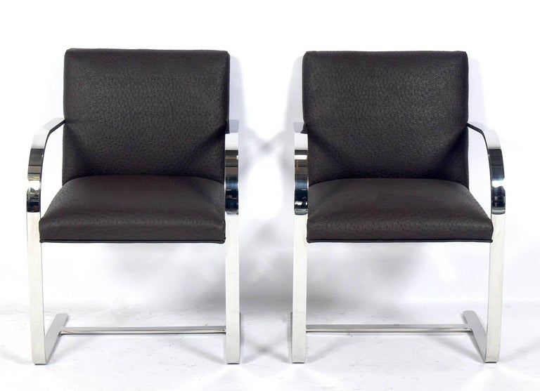 Set of four Brno chrome dining chairs after Mies van der Rohe, American, circa 1970s. These chairs are currently being reupholstered and can be completed in your fabric. The price noted below includes upholstery in your fabric.