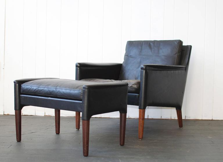Kurt Ostervig leather lounge chair and ottoman with rosewood legs. Down filled seat cushion, Denmark. Chair measures 29.5 wide x 31.5 deep x 30 high. Seat height 16. Ottoman measures 28 wide x 17 deep x 16 high.