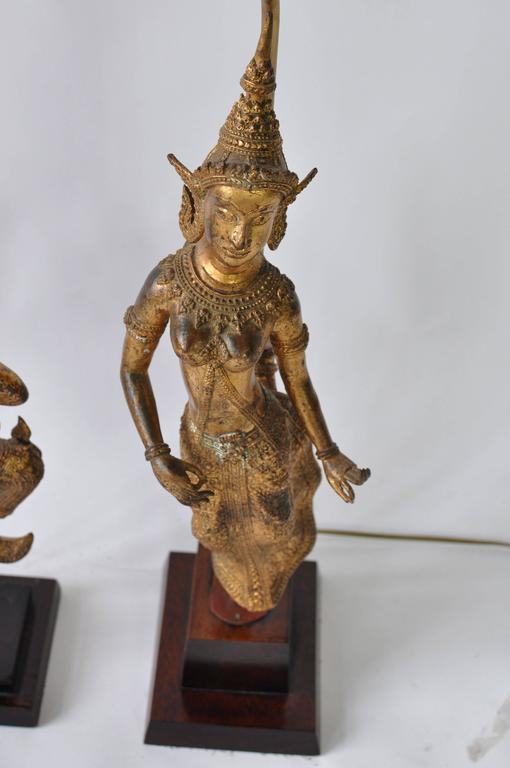 Collection of vintage Thai figure lamps. Gilt bronze over metal. Wood base. Priced as a collection or email for individual pricing.  Lamps measure from left to right. 35.5 tall X 6 W X 7.25 d. 23 tall X 6.75 wide X 6.25 deep. 33 tall X 12.5