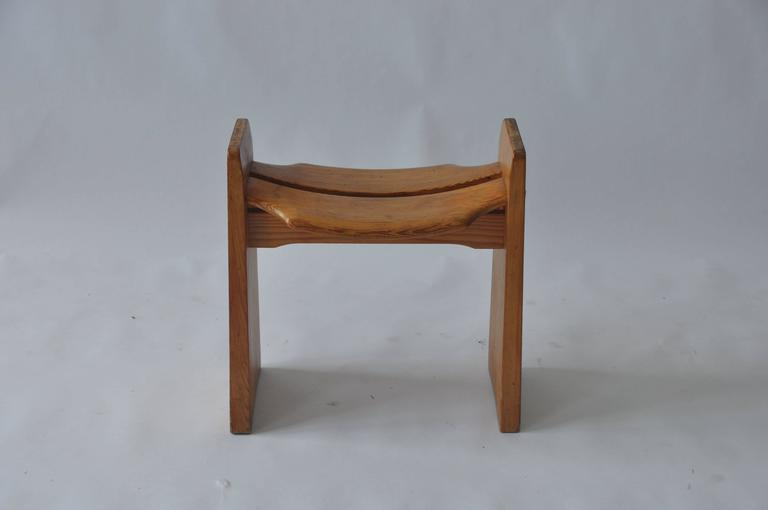 Solid pine stool by Gilbert Marklund, circa 1950s. Manufactured by Furusnickarn AB. Made in Sweden.
