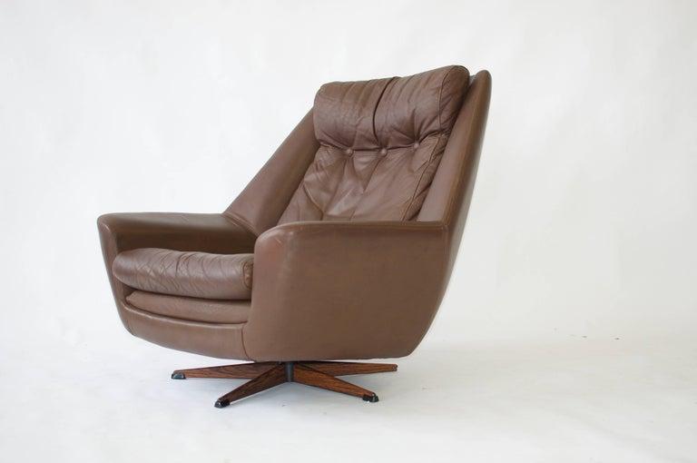 H. W. Klein swivel leather lounge chair.