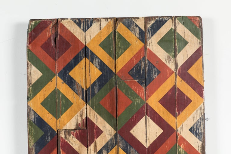 Bold geometric abstract board found in Texas. We have a collection of these boards from an anonymous artist. Painted on recycled cupboard doors, table tops, stool tops and bread boards. Very dynamic when hung in collections. Old beadboard. 
