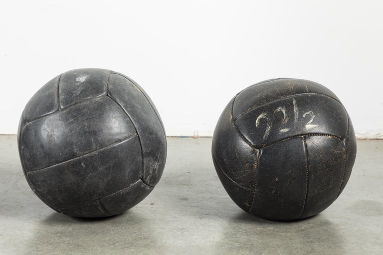 Folk Art Collection of Three Black Vintage Leather Medicine Balls For Sale