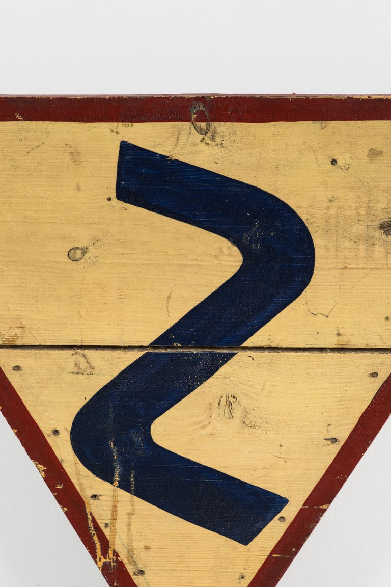 Early American road sign. Curved road ahead! Great patina and alligatored paint surface. Very heavy wood construction. Perhaps a one of a kind sign for a private country road. Nice graphic wall art.