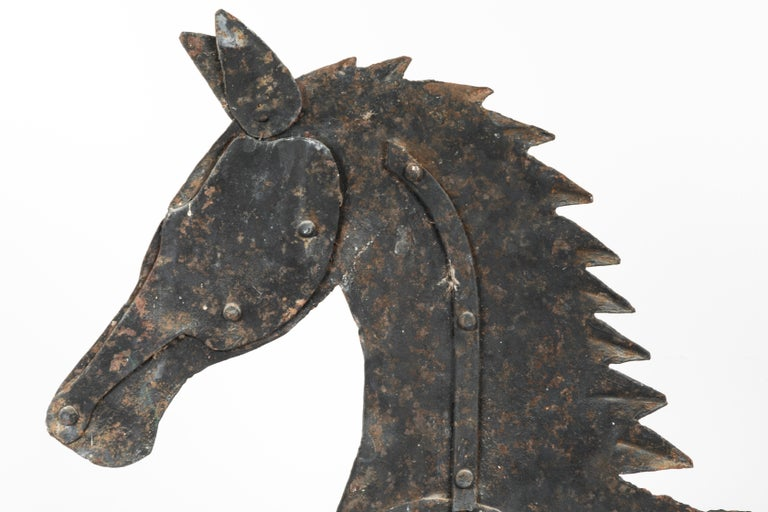 Ex. Jane Cipley collection. Fantastic sheet and strap iron horse weathervane. Originally found in the midwest. Old make-do repair to tail. Great piece of Americana.
