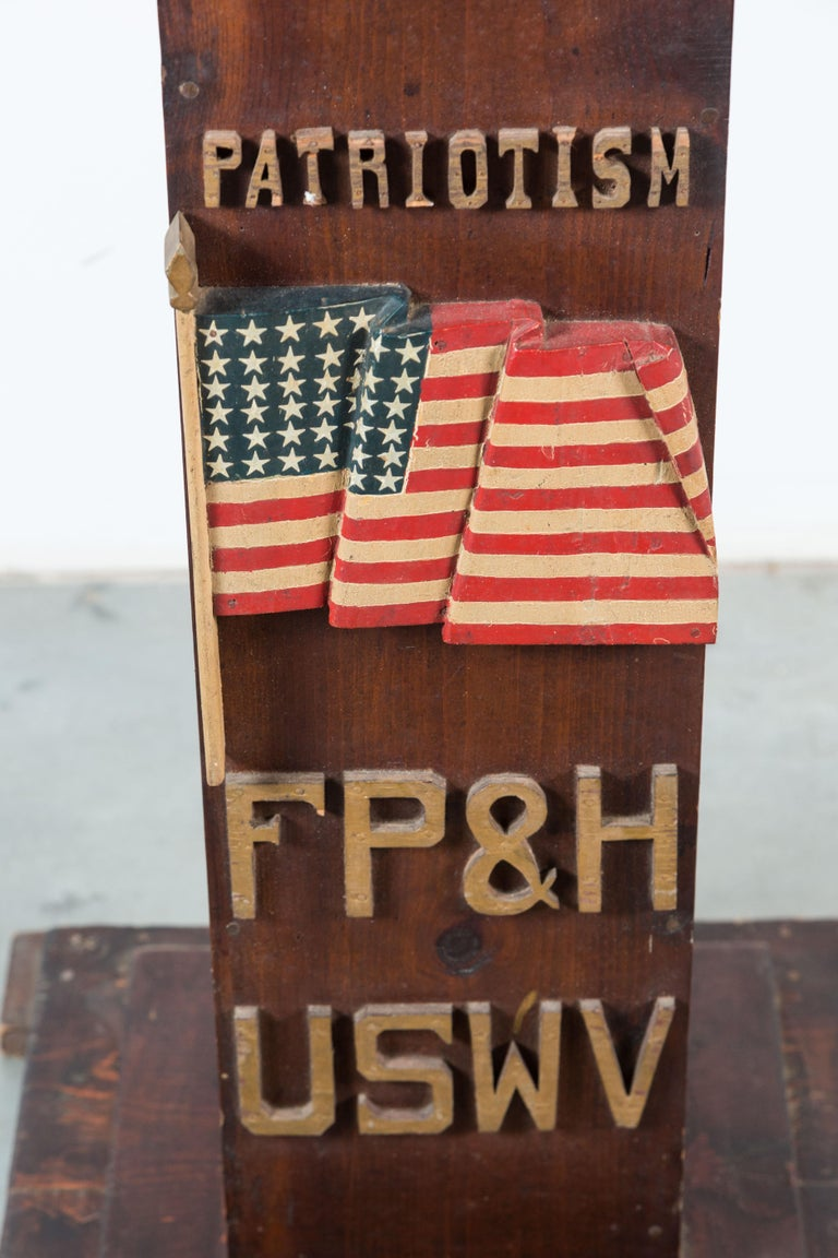 Fantastic pair of ceremonial lodge pedestals from United Spanish War Veterans lodge in Toledo, Ohio. One with a very well carved and three dimensional American Flag marked Patriotism. The other has carved and clasped hands marked Friendship and