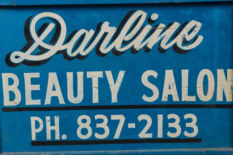 Late 1940s-1950 beauty salon sign. Graphic blue and white paint surface. Painted by the hand of a professional sign maker. Old vintage metal fasteners on each joined corner.