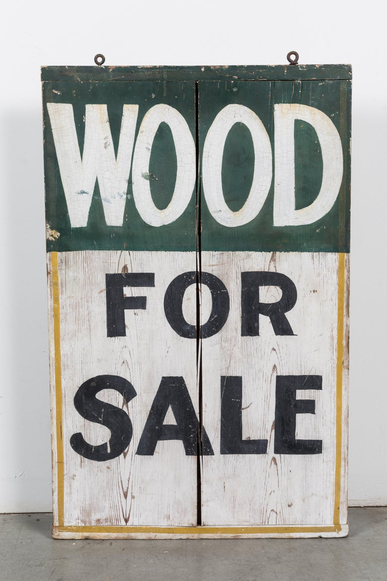Double sided general store trade sign, circa 1900. Each side perfectly graphic. Appears to have been done by the hand of a professional sign painter. One side ice for sale and the other side wood for sale.