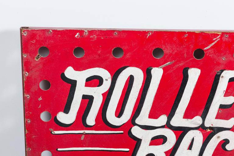 1950s carnival midway hand-painted roller racer sign. Holes were most likely for light bulbs. This sign no longer has any electrical attached. Solid iron frame on the back. Original paint surface and hand lettering. Most likely painted by a carney