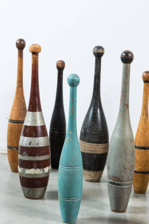 Large collection of 15 Indian clubs or juggling pins with original paint surface. Great alligatored patina on many. Late 19th and early 20th century clubs. Indian clubs rose to popularity in the US during the health craze of the late Victorian era.