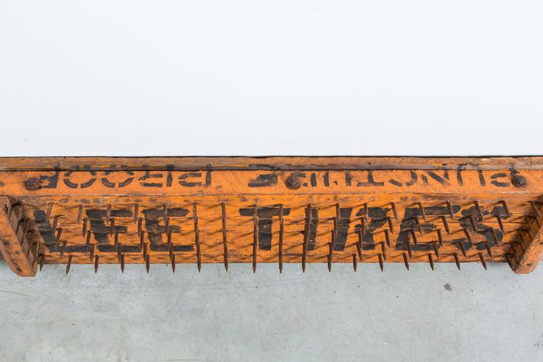 Early 20th century Lee Tires puncture proof trade sign. Handmade and painted wood and nail construction. Great orange and black paint surface.