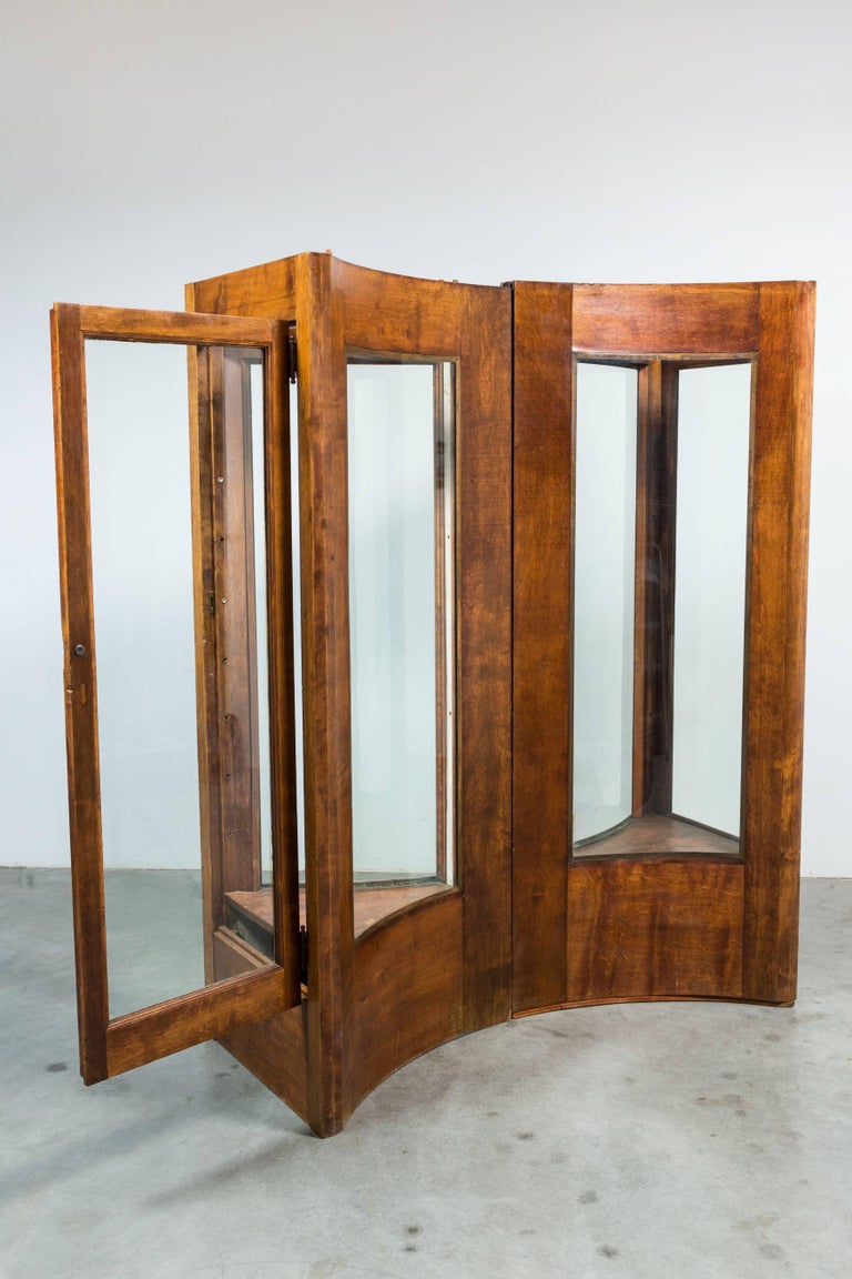 Fantastic oak display cases. Join together to form a bowtie shape. Each has one door for access and original glass shelves (not shown in images). Very solid and sturdy. These are really cool and work in a house or hotel or restaurant setting that
