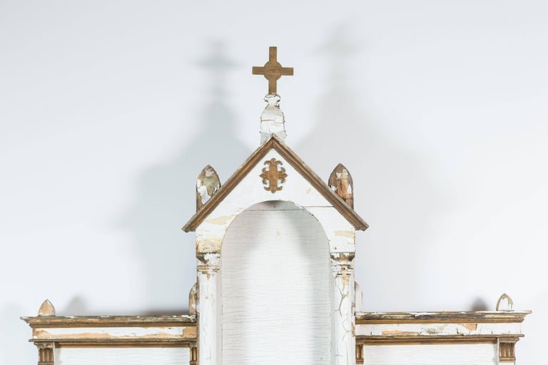 Large-scale North American church altar found in the midwestern United States. Most likely Canadian made. Traces of original white and gold paint surface. Chalice lock box with original key. Marble in front that appears to be wine stained from many